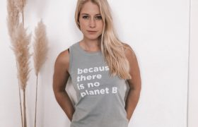 Woman wearing There is no Planet B tank top