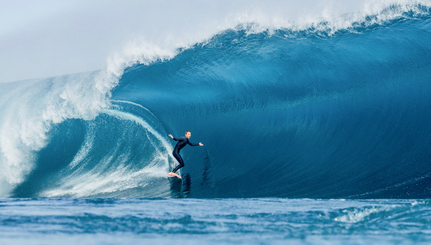 Imogen Caldwell surfing big wave in Teahupoo