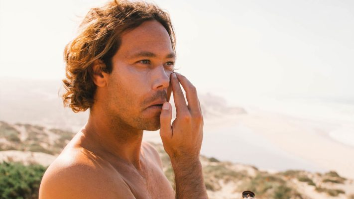Jordy Smith putting on SWOX sunscreen