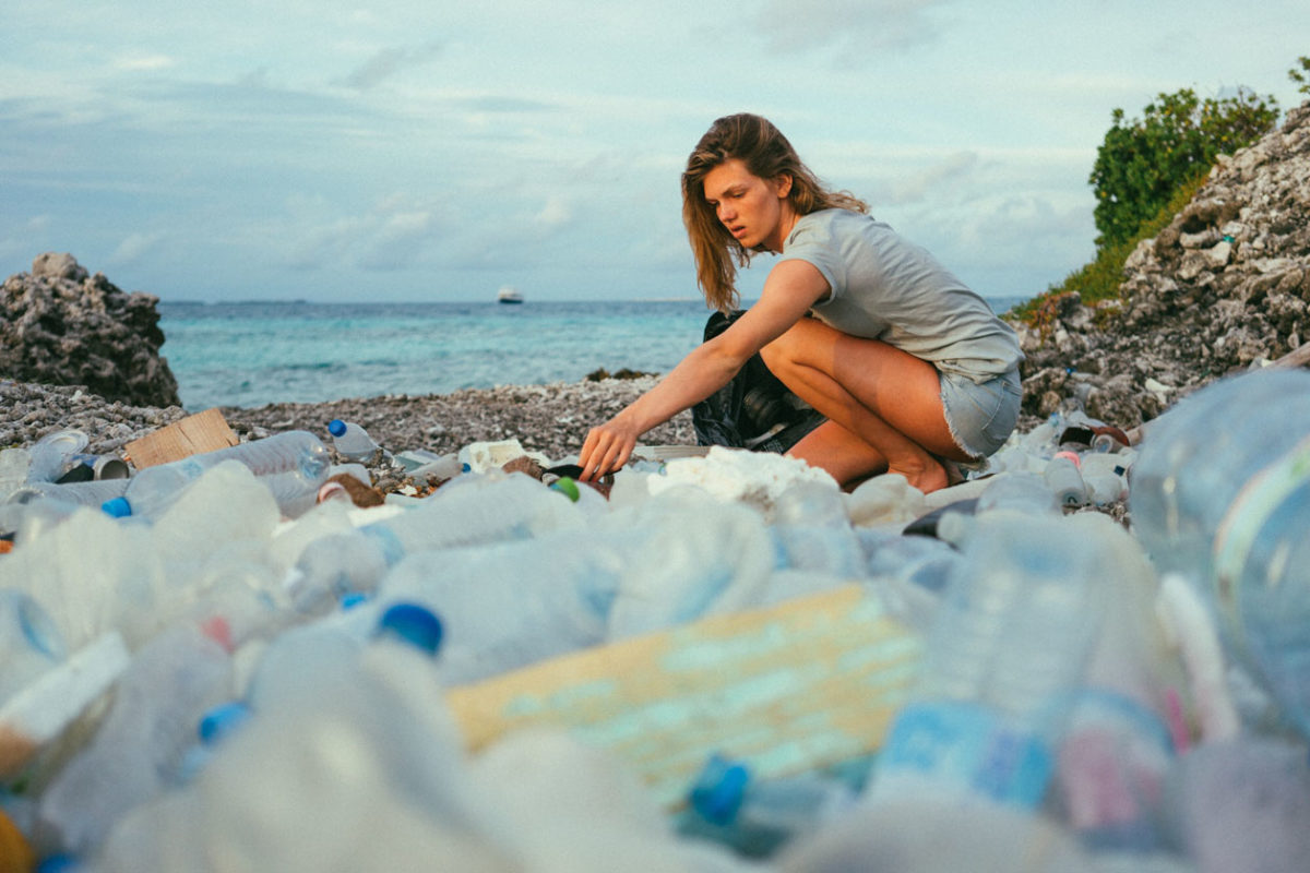 Lilly von Treuenfels collecting plastic bottles on the beach