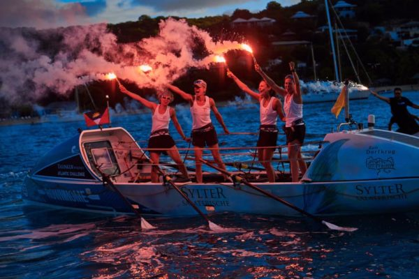 Team RowHHome at the finish line at sea in the Caribbean